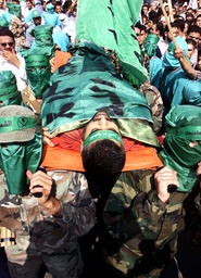 PALESTINIANS CARRY THE BODY OF THEIR FRIEND ABDEL RAHMAN HAMAD IN QAQILYA