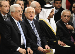 Palestinian President Mahmoud Abbas attends a midnight mass in St. Catherine's Catholic Church which connects with the Church of Nativity in the West Bank town of Bethlehem