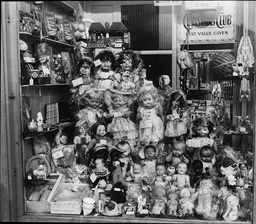 A Shop Window Full Of Dolls For Christmas