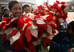Children hold decorations to take part in a Christmas celebration at a church in Kathmandu