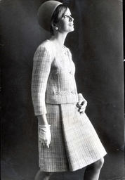 Fashion... Model: Bridget Leigh. Designer: Reldan Digby Morton. A Soft Pretty Suit In Natural Wool And Mohair With Flecked Turquoise. The Neckline Is Collarless The Skirt Swings With Two Unpressed Pleats.