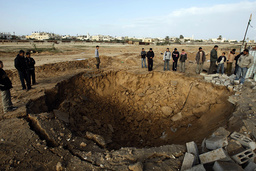 Palestinians look at destroyed tunnels on the Gaza-Egypt frontier