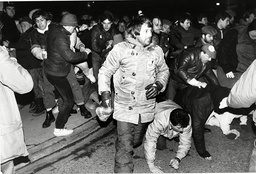 News International Strike 1986: Pickets Break Through Police Barriers Outside Rupert Murdoch's Printing Plant At Wapping.