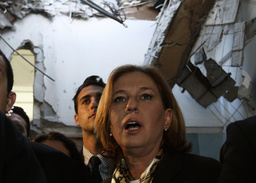 Israel's Foreign Minister Livni surveys damaged classroom in Beersheba