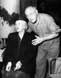 Cecil B. DeMille, right, and his wife, Constance DeMille, on the set of SAMPSON AND DELILAH, Novembe