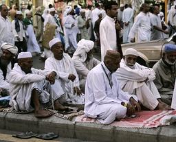 Pilgrims performing the haj wait before prayers outside the Grand Mosque of Mecca in Saudi Arabia