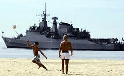 A Brazilian navy ship patrols the Copacabana beach in front of the Copacabana Palace where the Brazil-European Union summit will be held in Rio de Janeiro