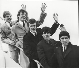 The Dave Clark Five Pop Group Waving From Steps Of Plane Before Leaving London For Tour Of America 1966.