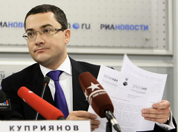 Gazprom spokesman Kupriyanov holds documents of Ukraine's state energy firm Naftogaz during news conference in Moscow