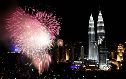 Fireworks explode near Petronas Twin Towers to celebrate the New Year in Kuala Lumpur