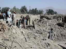 AFGHANS VIEW THE RUBBLE OF HOUSES DEMOLISHED AFTER U.S. BOMBING