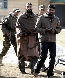 Indian army soldiers escort Kashmiri suspected militants during surrender ceremony in Nougam