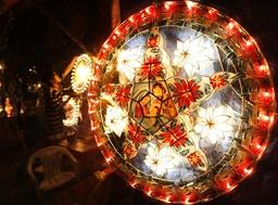 A lantern vendor arranges Christmas lanterns at his stall in Manila