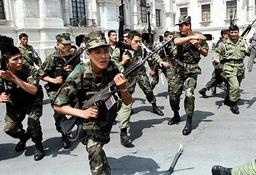 PERUVIAN SOLDIERS RUN AGAINST DEMONSTRATORS