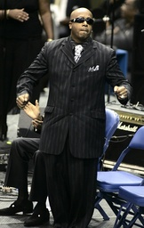 Entertainer M.C. Hammer dances on stage during the public funeral service for James Brown at the James Brown Arena in Augusta