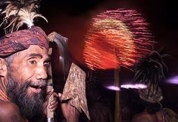 AN EAST TIMORESE MAN WATCHES FIREWORKS DURING INDEPENDENCE CELEBRATIONS IN DILI