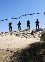 BSF soldiers patrol border at India-Pakistan International Border Post