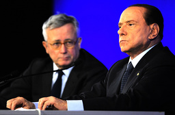 Italy's Prime Minister Berlusconi addresses a news conference with Italian Finance Minister Tremonti at the end of the G20 Summit in Cannes