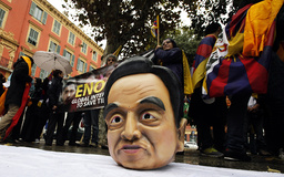 A plastic head portraying China's President Hu Jintao (C) is seen on the floor during a protest in Nice