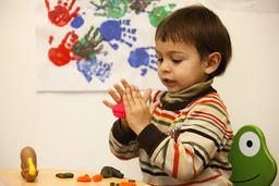 Boy playing with playdoo