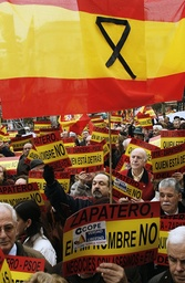 People shout slogans against Spanish PMz Zapatero during a demonstration in downtown Madrid
