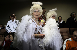 People in costumes attend the draw for the world's richest lottery, known as El Gordo or the fat one, in Madrid