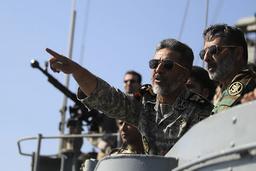 Iran's Navy commander Habibollah Sayyari points while standing on a naval ship during Velayat-90 war game on Sea of Oman near the Strait of Hormuz in southern Iran