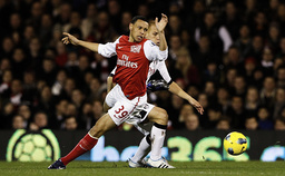 Fulham's Sidwell challenges Arsenal's Coquelin during their English Premier League soccer match in London