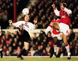 DAVID BECKHAM FIGHTS FOR THE BALL WITH TONY ADAMS IN LONDON
