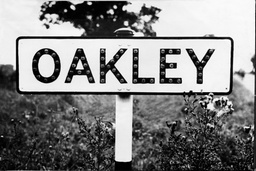Oakley Village Sign - The Farmhouse Hideout Of The Great Train Robbers Was Nearby The Great Train Robbery - A Ii2.6 Million Train Robbery Committed On 8 August 1963 At Bridego Railway Bridge Ledburn Near Mentmore In Buckinghamshire England. The Gang