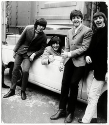 John Lennon (died December 1980) Does A Thumbs Up As He Passes His Driving Test His Band Members Congratulate Him In The Emi Studios Car Park Lennon Is At The Wheel Of George Martin''s Car. (l-r) George Harrison (died November 2001) Lennon Paul Mccar