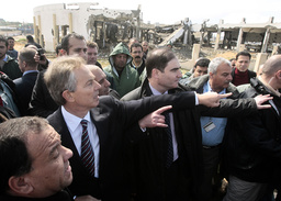 Middle East envoy Tony Blair looks at a sewage treatment facility during his visit to Beit Lahiya in the northern Gaza Strip