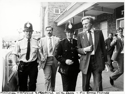 Mp Michael Heseltine (then Environment Secretary) Escorted By Police After A Mob In Liverpool Pelted Him With Eggs And Rotten Fruit As He Left Moss Lane Community Centre 3/8/1982.