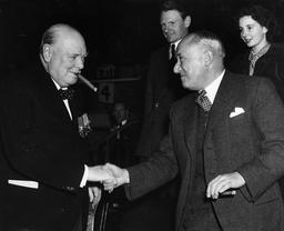 Al Alemain Reunion At The Empress Hall In Earls Court London. Mr Winston Churchill Greets Mr Emanuel Shinwell.