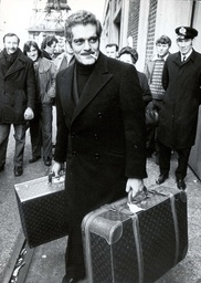 Actor Omar Sharif With Louis Vuitton Suitcases And Cigarette In Mouth Coming Ashore After Filming 'juggernaut' Aboard Ts Maxim Gorkiy.