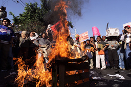 PROTESTERS BURN EFFIGY DURING DEMONSTRATION IN MONTERREY