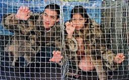 MODELS CRAMMED INTO A CAGES FOR ANTI-FUR DEMOSTRATION IN MILAN