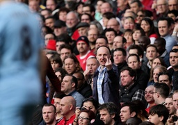 Arsenal v Manchester City London UK 29 03 14 An Arsenal fan sticks up his middle finger tow