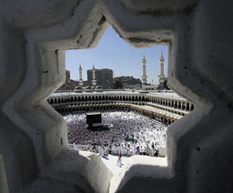 Muslim pilgrims perform Friday prayers around the Kaaba at the Grand Mosque in Mecca