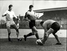 Eddie Reynolds Wimbledon Footballer (centre) With Goalkeeper Ames (right) Wimbledon V Colchester United Eddie Reynolds (born C. 1935 Died 1993) Was A Northern Irish Footballer. Eddie Reynolds Joined Wimbledon Fc From Tooting & Mitcham United Fc Durin