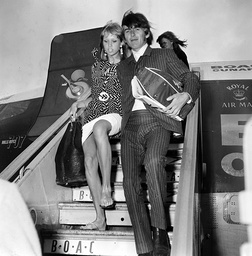 GEORGE HARRISON AND WIFE, PATTIE BOYD, PICTURED AT LONDON AIRPORT ON THEIR ARRIVAL FROM BAHAMAS, WHERE THEY SPENT THEIR HONEYMOON. 25/02/65