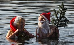 Members of Berlin's ice swimming club Berliner Seehunde take a dip in lake Orankesee in Berlin