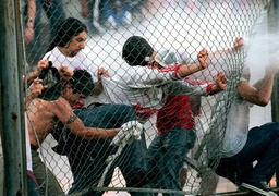RIOTING SOCCER FANS TRY TO BREAK THROUGH FENCE IN BUENOS AIRES