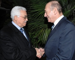 Israel's PM Olmert and Palestinian President Abbas shake hands in Jerusalem