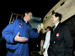 Swedish astronaut Fuglesang speaks with Tognini of France after landing at the Kennedy Space Center in Cape Canaveral