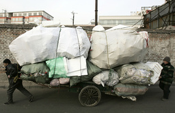 Workers transport trashed plastic foam for recycling on a street in Taiyuan