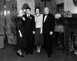 Cecil B. DeMille and his wife Constance DeMille (far right and left) with their daughter Cecilia DeM