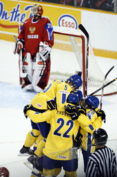 Team Sweden celebrate Peterson scoring their fourth goal against Team Russia during their hockey game at the 2009 IIHF U20 World Junior Hockey Championships in Ottawa