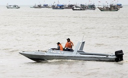 An Indonesian naval ship patrols at Rembang beach to search for survivors of ferry sinking in Central Java province