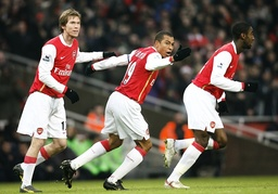 Arsenal's Gilberto celebrates after scoring a goal during their English Premier League soccer match at The Emirates Stadium in London